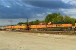 BNSF 9942 eases past the H-MEMKCK with the golden swoosh