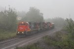 Now in a wind blown downpour, U714 comes up Proctor Hill with limestone loads