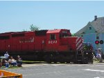 CP 6042 WB interrupts the 4th of July parade